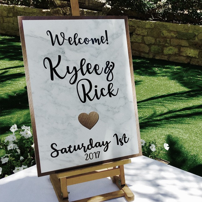 richie roo designs, wedding signage, personalised signage, welcome signage, order of the day, seating plan, paddle fans, social media sign, unplugged wedding, personalised wedding signage, table numbers, place cards, placecards, table names, aisle signage, handmade signage, wooden signs, wooden plaques, wooden heart plaques, personalised wooden signs, personalised wooden welcome sign, personalised wooden seating plan, acrylic signs, acrylic sign, acrylic seating plan, table plan, tableplan, table plan, themed weddings, paddle fan, cyprus weddings, cyprus wedding sign, cyprus wedding signage, prop frame, instagram frame, facebook frame, personalised frame, memoriam, metal frame, rustic wedding, rose gold wedding, heart